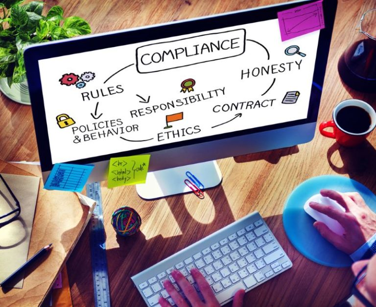 web design compliance mac computer screen on desk process cycle