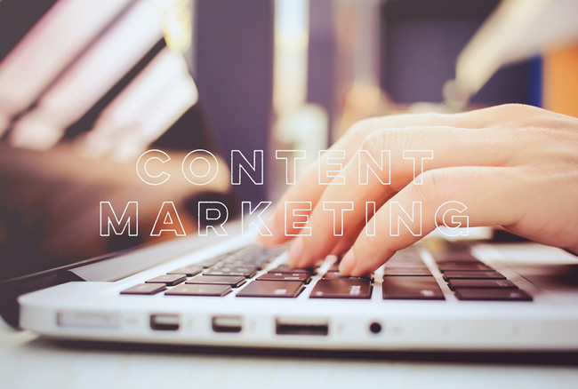 ecommerce content marketing hands typing on laptop mac book keyboard