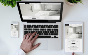 responsive hotel website on laptop phone and tablet